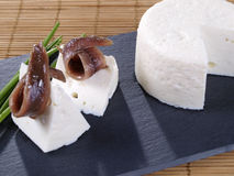 Anchovies and fresh cheese tapas. stock image
