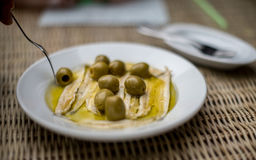 Anchovies with olives. Spanish tapas Stock Image