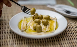 Anchovies with olives. Spanish tapas Stock Images