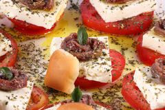 Anchovy apperitives. Small apperitives with anchovy, cheese, tomato, bread and spices Stock Photography