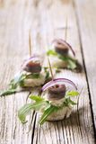 Anchovy canapes. Garnished with greens and onion Stock Photos
