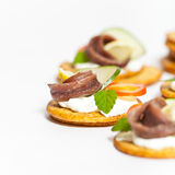 Anchovy filet. Canapes with pickled anchovy filet Stock Photos