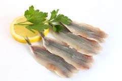 Anchovy fillets with lemon and parsley Royalty Free Stock Photos