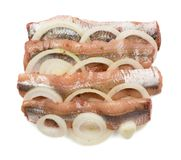 Anchovy filet isolated. Anchovy with onion rings isolated on white background. Fish filet with clipping path. Flat lay and top view Royalty Free Stock Photography