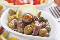 Anchovy salad. With olives and caper, classic italian food Stock Images