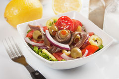 Anchovy salad. With olives, tomato, onion and pepper Royalty Free Stock Photography