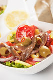 Anchovy salad. Fresh anchovy salad with olives and vegetable Stock Photo