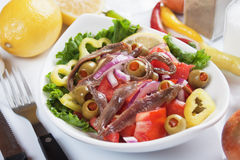 Anchovy salad. With olives and tomato, classic italian food Royalty Free Stock Photo