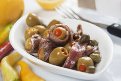 Anchovy salad. With olives and caper, classic italian food Royalty Free Stock Image
