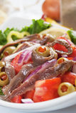 Anchovy salad. With olives and tomato, classic italian food Royalty Free Stock Image
