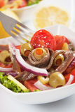 Anchovy salad. With olives and tomato, classic italian food Stock Images