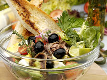 Anchovy salad. W olives and french bread Royalty Free Stock Photo