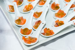 Anchovy salmon. Appetizer of salmon lying in the ceramic spoons Stock Image