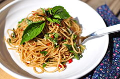 Anchovy spaghetti with basil in white plate Stock Photo