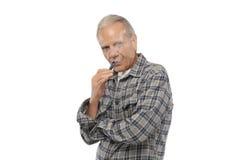 Ancião que fuma o cigarro eletrônico do vapor Imagem de Stock