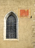 Anciant church window with sun dial Stock Photography