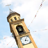ancien clock tower in ita ly europe old  stone and bell Royalty Free Stock Image