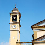 ancien clock tower    in italy europe old  stone and bell Stock Photo
