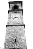 ancien clock tower in     italy europe old  stone and bell Royalty Free Stock Photos
