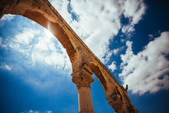 Ancien stone arc on the background of sunny, cloudy sky Royalty Free Stock Images