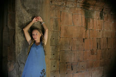 Ancien wall and young girl. Young girl standing at the ancient brick wall Stock Images