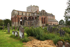 Anciens prory. Medieval Lanercost Priory was founded about 1165 by Henry II and was completed in 1220. It fell into ruin after the dissolution of the monasteries Royalty Free Stock Image