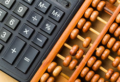 Ancient abacus and modern calculator Royalty Free Stock Image