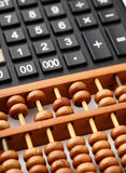 Ancient abacus and modern calculator Stock Photos