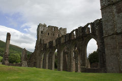 Ancient abbey ruins with arches in Brecon Beacons South Wales, UK. Clouds over the ancient ruins at Llanthony Priory in Brecon Beacons, South Wales, Uk Royalty Free Stock Photos