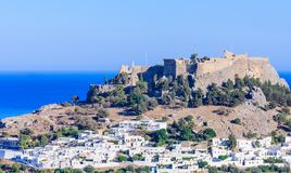 The ancient Acropolis of Lindos and the modern city. Rhodes Stock Images