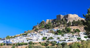 The ancient Acropolis of Lindos and the modern city. Rhodes Royalty Free Stock Image
