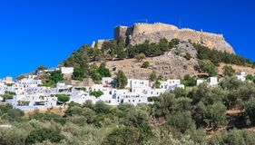 The ancient Acropolis of Lindos and the modern city. Rhodes Royalty Free Stock Images