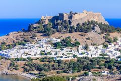 The ancient Acropolis of Lindos and the modern city. Rhodes Stock Photography