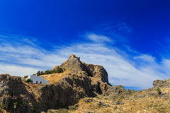 The ancient Acropolis of Lindos and the modern city. Rhodes Island. Greece Royalty Free Stock Photo