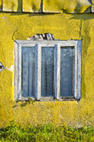 Ancient and aged window on old house wall Royalty Free Stock Image