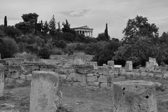 Ancient agora athens. View to the temple of hephaestus from the ruins of the ancient agora in Athens, Greece. Black and white Stock Photo