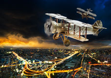 Ancient airplane over city Royalty Free Stock Image