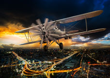 Ancient airplane over city royalty free stock photography