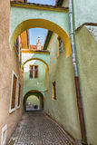 Ancient alley with arches in Romania. Royalty Free Stock Images