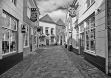 Ancient alley with lovely shops in the touristic ancient city of Heusden, The Netherlands. stock photography