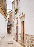 Ancient alley of Martina Franca. Apulia. Stock Photos