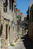 Ancient Alley. Narrow alley with old stone houses in ancient city at sunny summer day Royalty Free Stock Photos