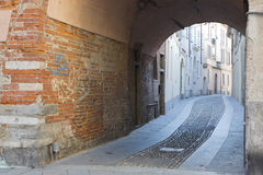 Ancient alley in Pavia Italy Stock Images