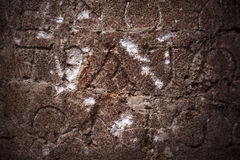Ancient Alphabets on Marble Background Royalty Free Stock Photos