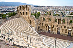 Ancient amphitheater at Acropolis, Athens, Greece. Ruins of ancient amphitheater at Acropolis hill, Athens, Greece Royalty Free Stock Photos
