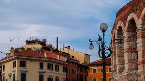Ancient Amphitheater Arena, Ancient Buildings and Lantern in Verona stock photos