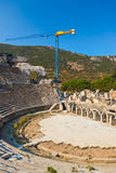 Ancient amphitheater and construction crane in Ephesus Stock Photos