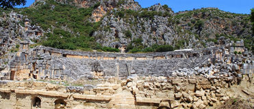 Ancient amphitheater and Lycian tombs Stock Images