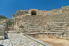 Ancient amphitheater ruins. In Ephesus on sunny day against clear blue sky, Turkey Royalty Free Stock Photo