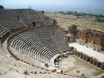 Ancient amphitheater. In sunny day in turkey. View on sea Royalty Free Stock Photo